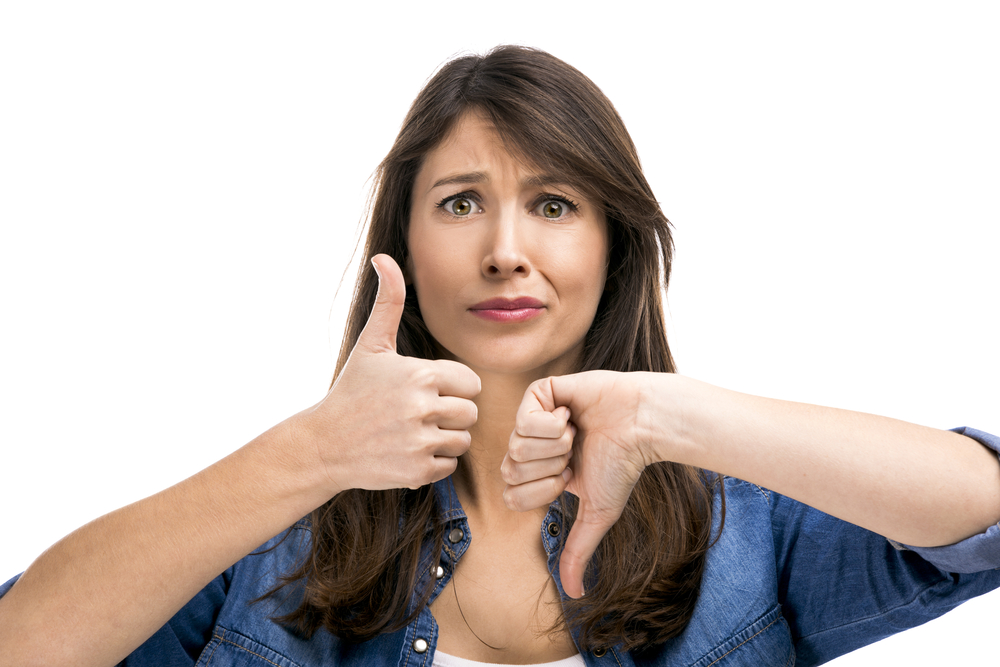 Woman with one thumb up and one down