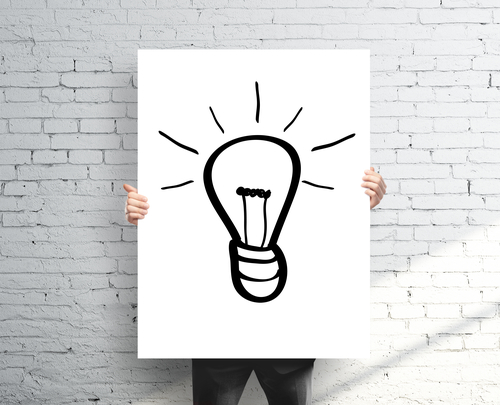 businessman holding poster with drawing lamp